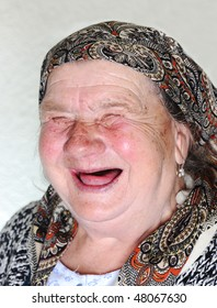 Elderly person, portrait in natural pose laughing