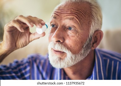 Elderly Person Using Eye Drops