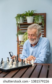 Elderly playing chess in nursing home for leisure