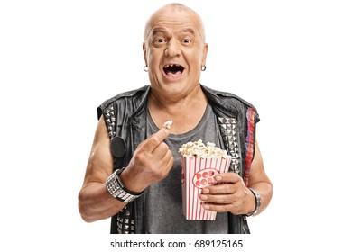 Elderly punker having popcorn and laughing isolated on white background