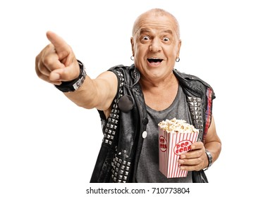 Elderly punker with a popcorn box pointing and laughing isolated on white background