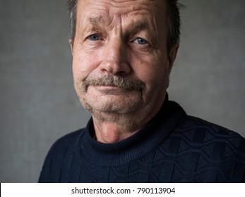 Elderly sad man close-up portrait
