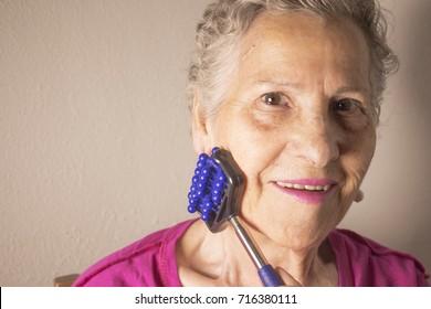 Elderly self massaging the body for pain