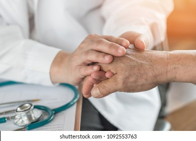Elderly senior adult patient having geriatric doctor (geriatrician) consulting and diagnostic examining on aging and mental health care in medical clinic office or hospital examination room