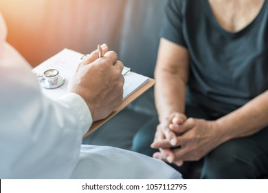 Elderly senior aged adult patient having examination on aging and mental health care with geriatric doctor (geriatrician) working on consulting and diagnostic in medical clinic hospital exam room