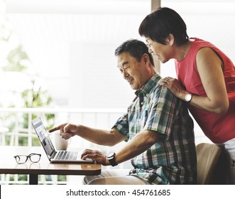 Elderly Senior Couple Computer Home Concept