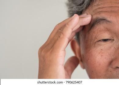 elderly senior old man citizen suffering from dementia; sick elderly senior old man with memory loss; ill retired senior old man with mental problem; depressed senior old man pensioner with depression
