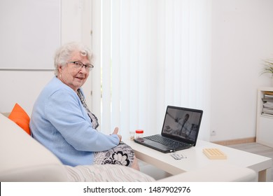 elderly senior woman, having a remote medical consultation with her doctor over internet computer telemedecine diagnostic