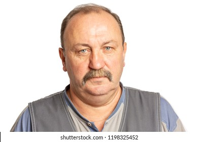 Elderly serious man with a mustache, close-up