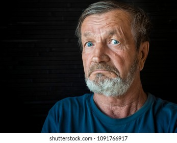 Elderly shocked man close-up portrait
