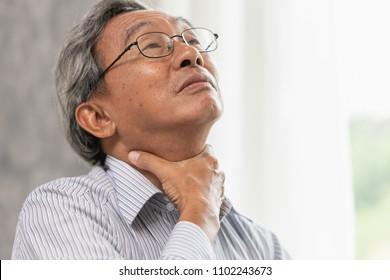 elderly sore throat irritation hand massage squeeze at neck