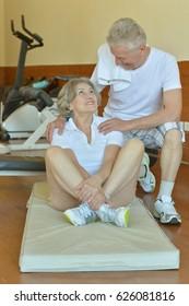 Elderly in sportswear practice sports