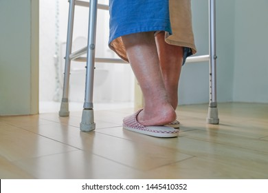 Elderly swollen feet or edema leg walk into bathroom