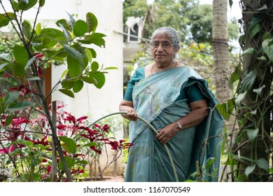 An elderly woman after his retirement practices farming and pursues gardening to keep himself engaged.