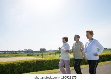 Elderly woman of Asian of three people walking down the road