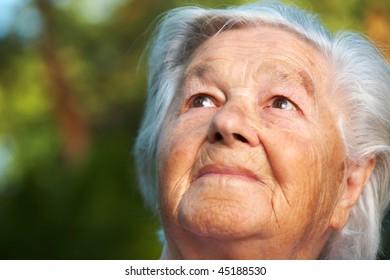 Elderly woman being pensive