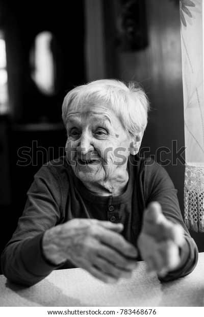 An elderly woman black and white portrait.