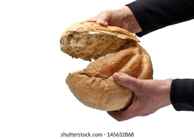 An elderly woman breaking a loaf of bread. Could be used either for Lord's Supper or feeding the needy. Over white with copy space.