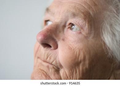 Elderly woman bringing back memories.