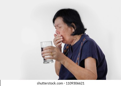 elderly woman Choking a water drink after take  medicine ,isolated on white background
