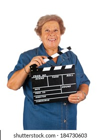 Elderly woman with clapper board on white background