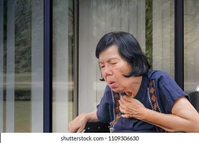 elderly woman cough ,choke