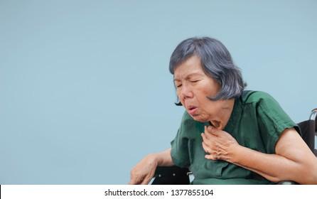 elderly woman cough ,choke on wheelchair