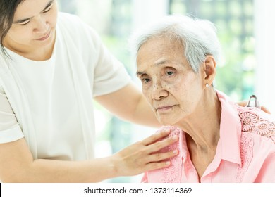 Elderly woman with depressive symptoms need close care,asian woman carer supporting,Alzheimer patient, depressed senior woman at home feeling sad,depression concept