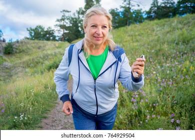 Elderly woman doing sport outside
