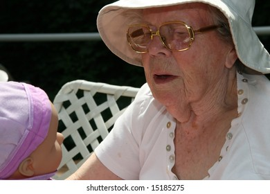 elderly woman with doll