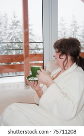 Elderly woman drink coffee at home