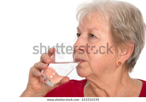 elderly woman is drinking water