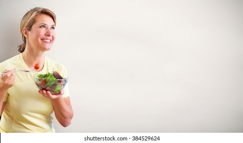 Elderly woman eating salad.