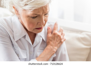 Elderly woman is enduring awful ache