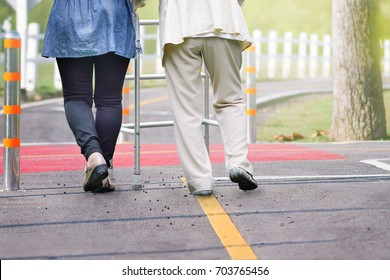 Elderly woman exercise walking in road with daughter with daughter