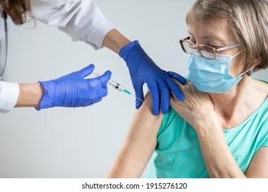 elderly woman getting coronavirus vaccine