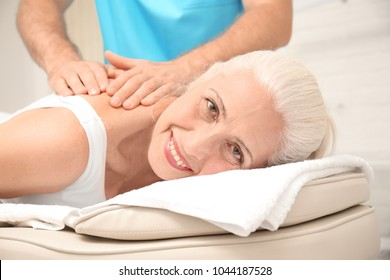 Elderly woman getting massage at physical therapy office