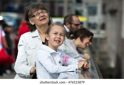 Elderly woman and granddaughter enjoying the London view from the bridge.