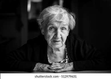 An elderly woman. Grandma, black-and-white close-up portrait.