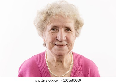 An elderly woman with gray curly hair laughs, isolated on white background