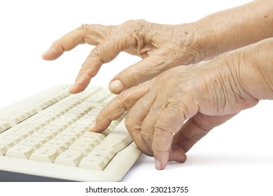 Elderly woman hands on computer keyboard