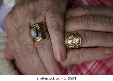 elderly woman hands with rings