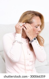 Elderly woman with hearing aid