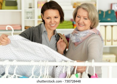An elderly woman with her daughter chooses things in the store