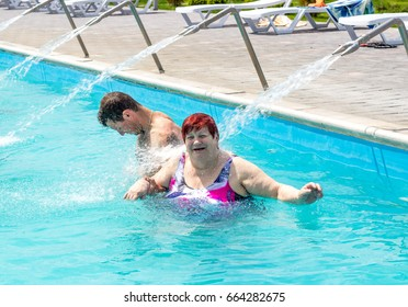 """An elderly woman and her grandson. Swimming pool with a warm thermal spring. """"Kazinka"""" south of Russia"""