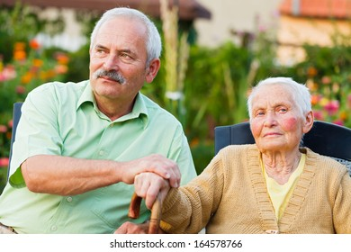 Elderly woman with her son in the residential home.