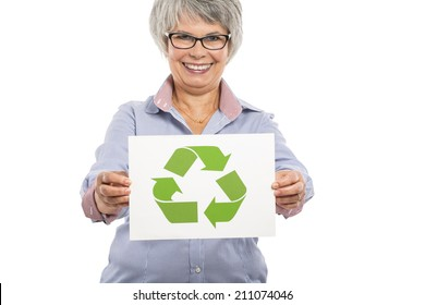 Elderly woman holding a paper card  with the recycling sign