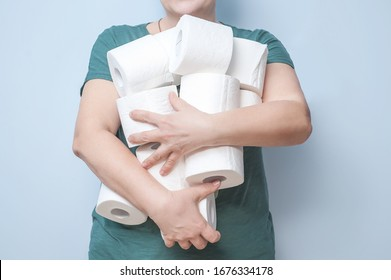 elderly woman holds many rolls of toilet paper in the toilet. excitement, greed, panic. human hands in the frame