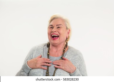Elderly woman laughing isolated. Cheerful senior lady.