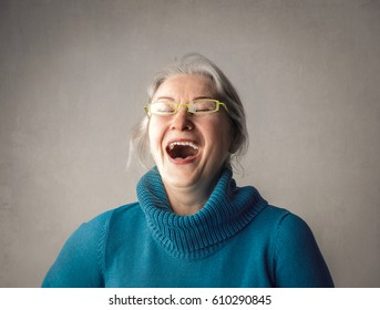 Elderly woman laughing out loud
